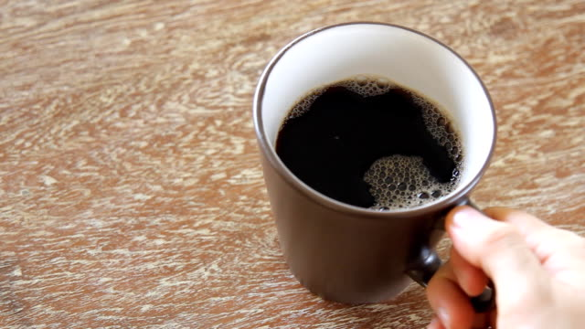 pouring coffee into a cup on wooden table - mug stock videos and b-roll footage