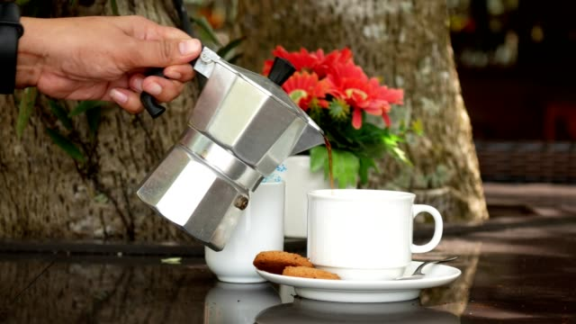 pouring coffee into a cup - teapot stock videos & royalty-free footage