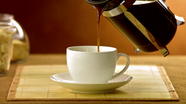 Pouring Coffee Into A Cup (Super Slow Motion)