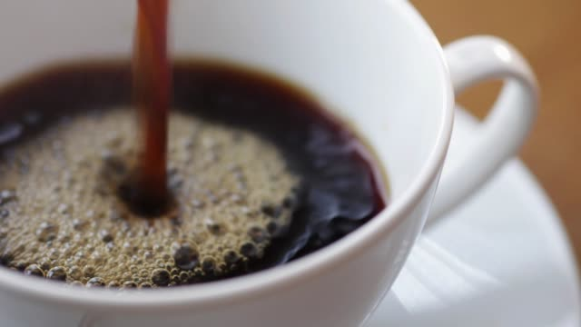 pouring coffee into a cup - coffee cup stock videos & royalty-free footage