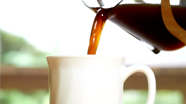 pouring coffee into a white cup and hand picking coffee cup - mug stock videos and b-roll footage