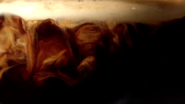 pouring coffee. mixing layers - swirl pattern stock videos & royalty-free footage