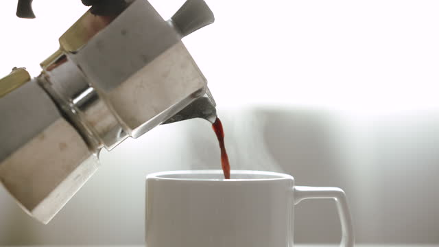 pouring coffee, pouring freshly brewed black coffee - coffee drink stock videos & royalty-free footage