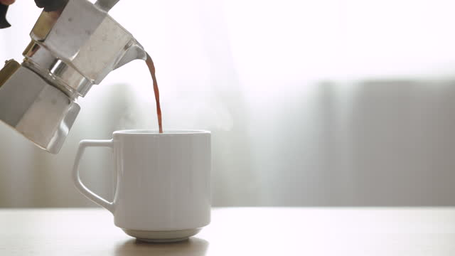 pouring coffee, pouring freshly brewed black coffee - pouring stock videos & royalty-free footage