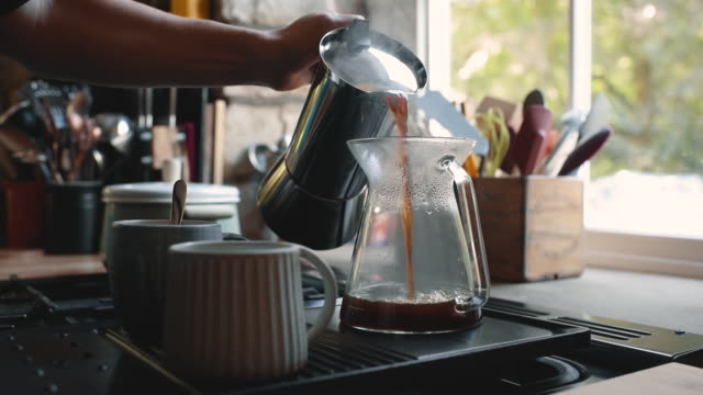 pouring coffee - routine stock-videos und b-roll-filmmaterial