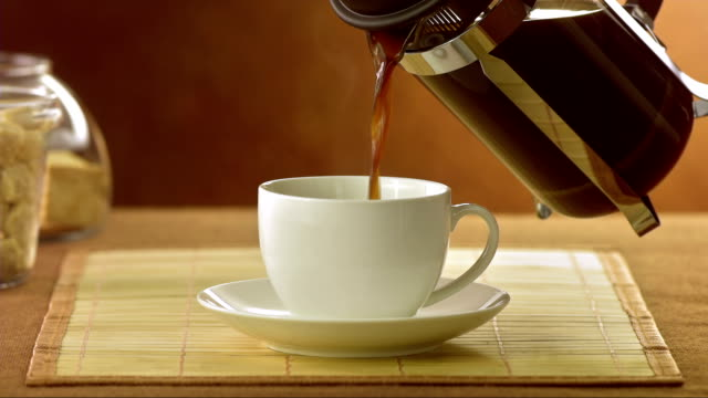 pouring coffee - coffee table stock videos & royalty-free footage