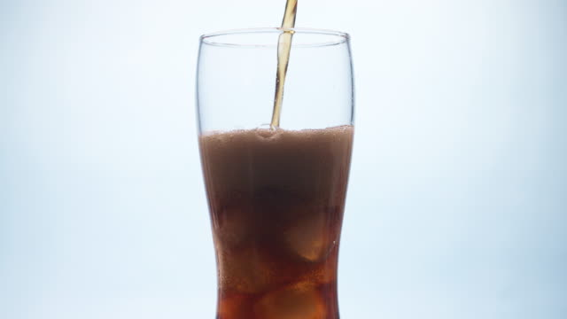 pouring cola in a glass - carbonated stock videos & royalty-free footage