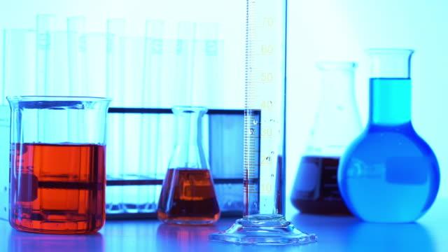 Pouring color liquid into laboratory grassware