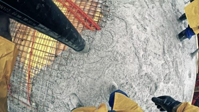 POV Pouring concrete onto the steel reinforcement net