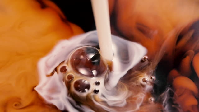 pouring cream into a cup of coffee - pouring milk stock videos & royalty-free footage