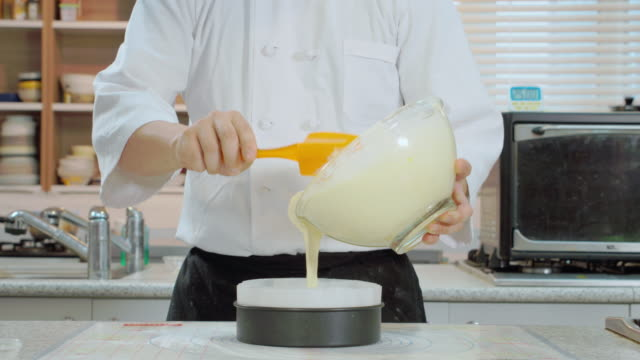 pouring dough into cake frame - batter food stock videos & royalty-free footage