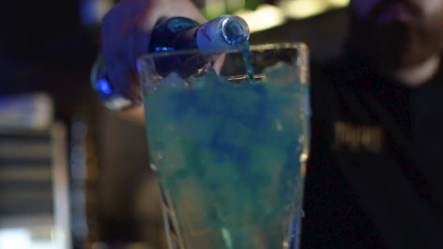 pouring drink in glass - bar drink establishment stock videos and b-roll footage