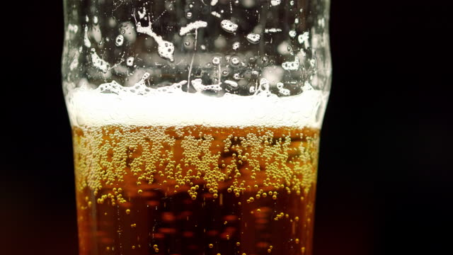 pouring drinks - beer glass stock videos & royalty-free footage