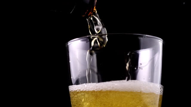pouring fresh beer - empty beer glass stock videos and b-roll footage