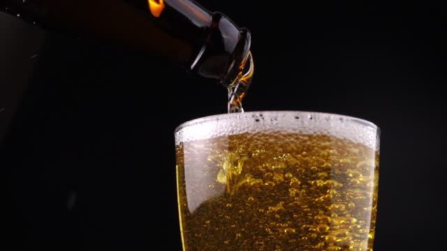 pouring fresh beer - bottle stock videos & royalty-free footage