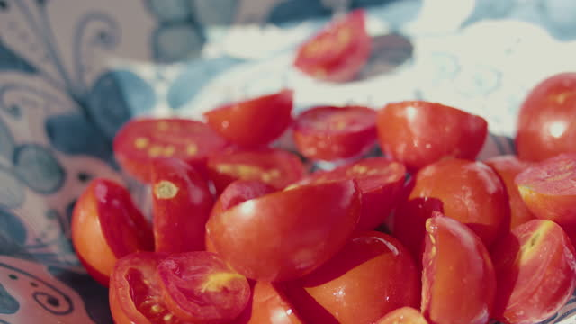 pouring fresh halved tomatoes into bowl - lunch stock videos & royalty-free footage