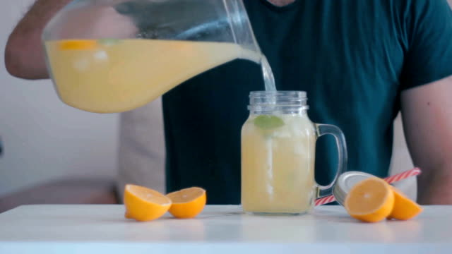 pouring fresh lemonade - cold drink stock videos and b-roll footage