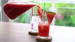 Pouring fresh watermelon juice