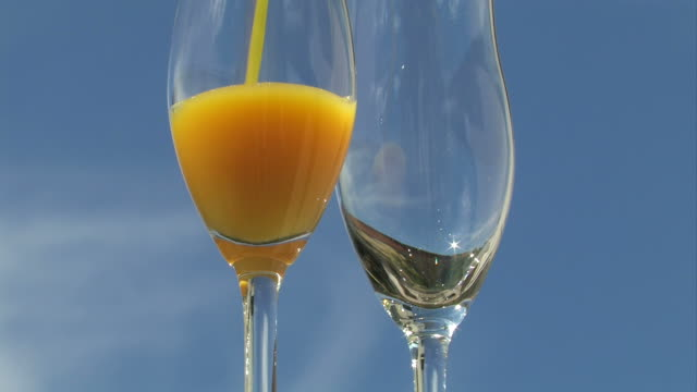 pouring glass of orange juice - orange juice stock videos and b-roll footage