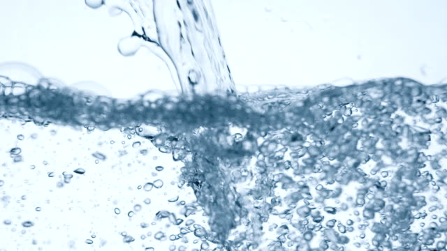 Pouring glass of water slow motion. Real video.