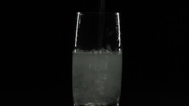 pouring glass of water - splashing droplet stock videos & royalty-free footage