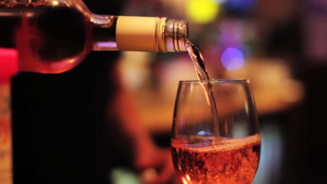 pouring glass of wine - close up - rose wine stock videos and b-roll footage