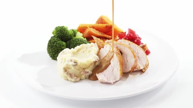 pouring gravy over roast turkey - roast turkey stock videos & royalty-free footage