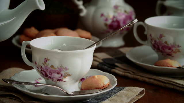pouring green tea into cup - teapot stock videos & royalty-free footage