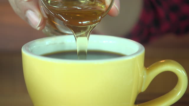 pouring honey into black coffee - pouring stock videos & royalty-free footage