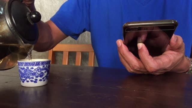 pouring hot black tea - teapot stock videos & royalty-free footage