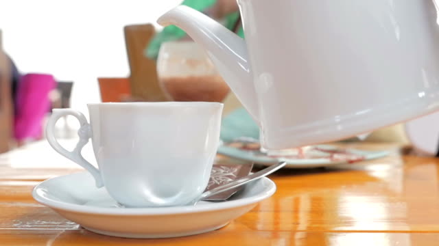 Pouring hot tea close up shot