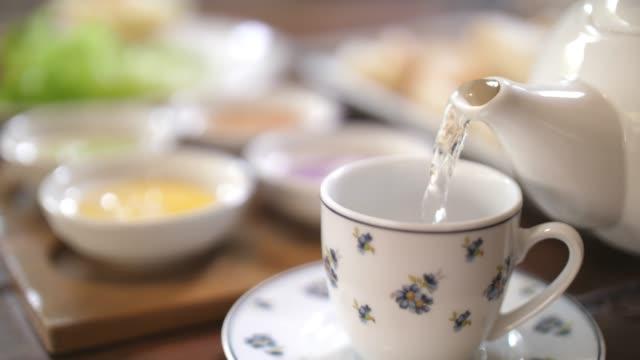 pouring hot tea in tea cup - ramadan stock videos & royalty-free footage