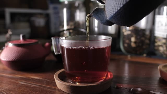 pouring hot tea to tea cup. - tea cup stock videos & royalty-free footage