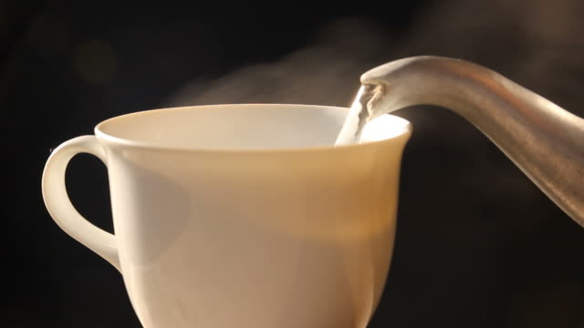 pouring hot water in to a coffee cup - cafe macchiato stock videos and b-roll footage