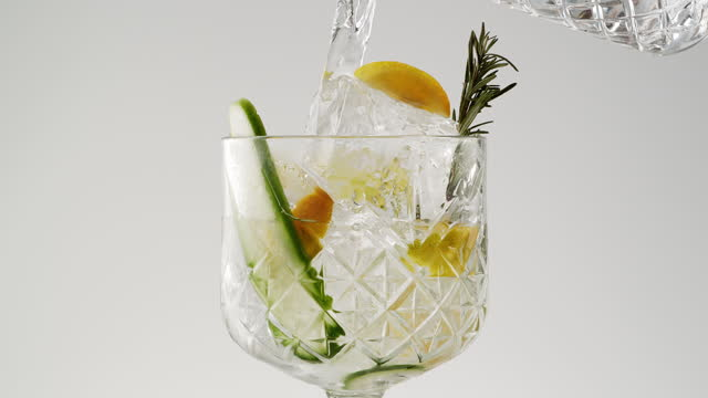 pouring in gin and tonic in glass - pouring stock videos & royalty-free footage