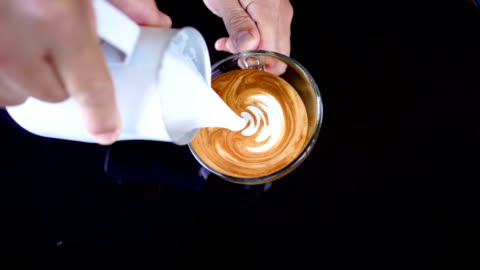 slo mo pouring latte art. - art and craft stock videos & royalty-free footage