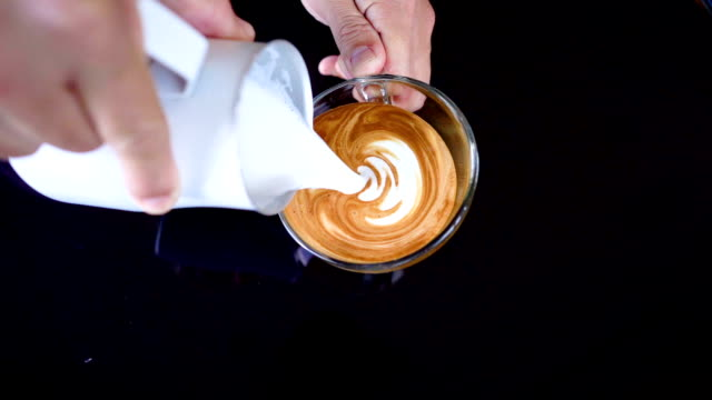 slo mo pouring latte art. - cup stock videos & royalty-free footage