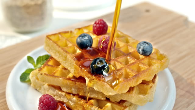 slo mo ld pouring maple syrup over waffles - maple syrup stock videos & royalty-free footage