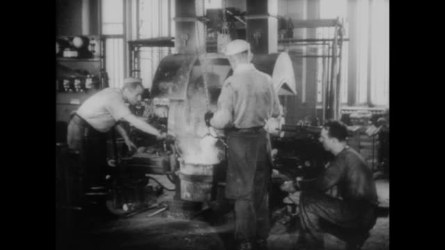 1940 pouring metal to create coins - money press stock videos and b-roll footage