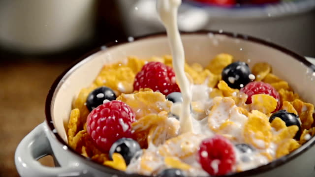 pouring milk into bowl with cornflakes - cereal plant stock videos & royalty-free footage