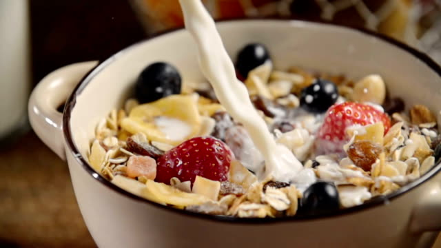 pouring milk into bowl with muesli cereals - wholegrain stock videos & royalty-free footage