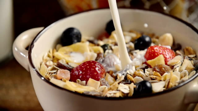 pouring milk into bowl with muesli cereals - protein bar stock videos & royalty-free footage