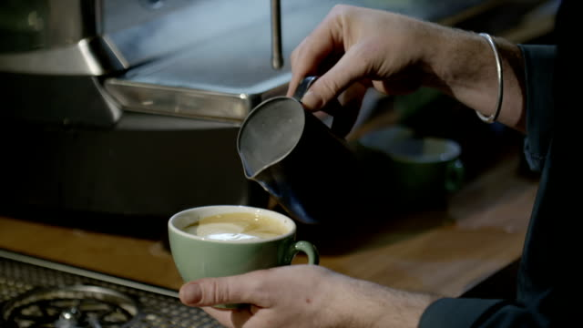 pouring milk into coffee - food styling stock videos & royalty-free footage