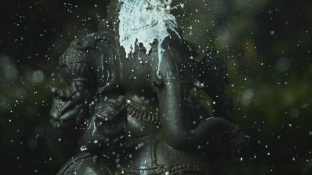 pouring milk over ganesha statue - religious celebration stock videos & royalty-free footage