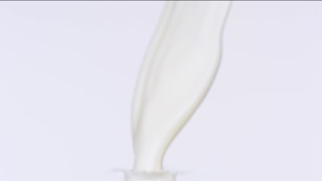 pouring milk - pouring milk stock videos & royalty-free footage