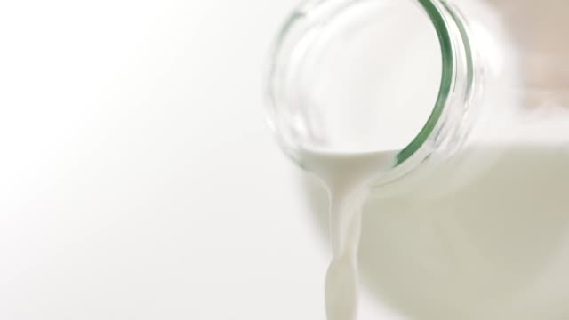 pouring milk - lactose fermentation stock videos & royalty-free footage
