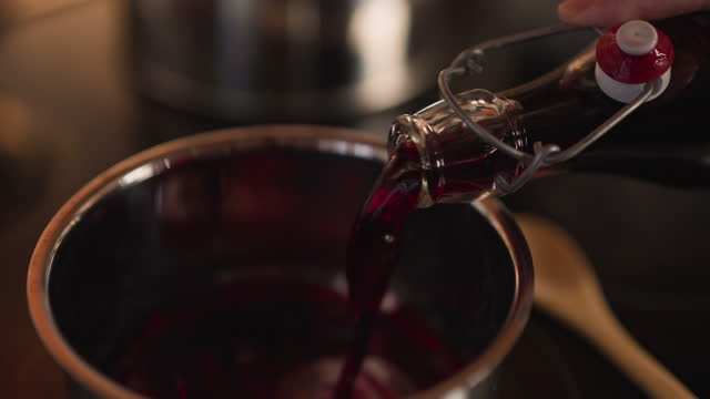pouring mulled wine into a cooking pan - cooking pan stock videos & royalty-free footage