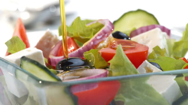 slo mo pan pouring oil over salad - food and drink stock videos & royalty-free footage
