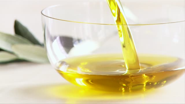 pouring olive oil into a small bowl - olive oil stock videos & royalty-free footage