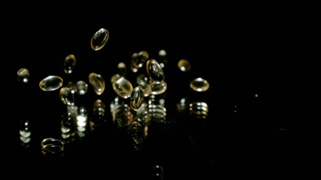 slo mo pouring omega-3 capsules - omega 3 stock videos & royalty-free footage